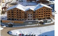 Alpine Charms - Les Menuires Style Apartment, Reberty 2000, 5 bedrooms, sleeps 10/12, Ski in / ski out in Three Valleys, France. Self Catered skiing apartment with spa facilities - access to sauna and hamman, free wifi and parking.